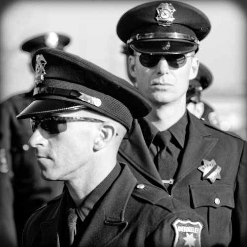 Police Response Time - Two policemen in black and white photo
