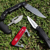 Best knives for self defense - My small collection of knives on the grass