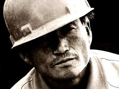 Tough old construction guy with facial hair and hard hat