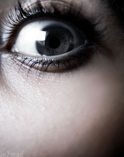 Your crime stories - close up of woman's eye showing fear