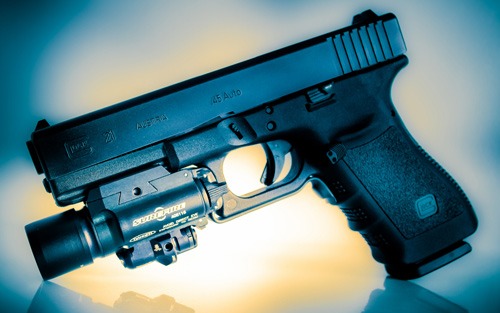 Survival Instincts - Glock handgun with light attached