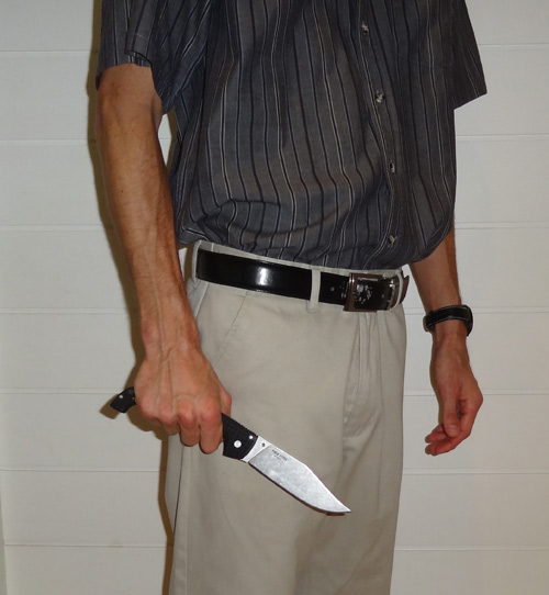 Man holding a Cold Steel Voyager X2 in hand