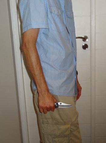 Benchmade Griptilian knife opened in hand