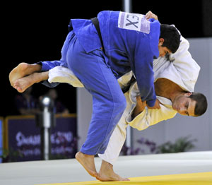 Martial art training - Judo player throwing another in competition