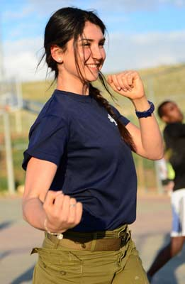 Krav maga girl punching during training