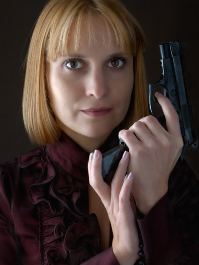 Ladies Weapon - Red haired woman holding black handgun