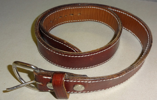 Clothing choices for self defense - Leather gun belt curled up on surface
