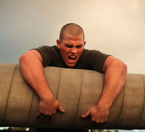 Muscular strength training - Soldier struggling with log