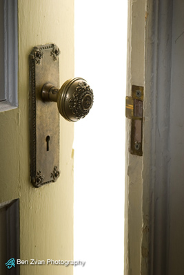 Crime Safety Tips - A door left lightly open with light shining through