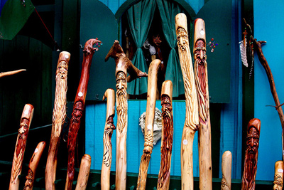 Several ornately carved walking sticks or canes