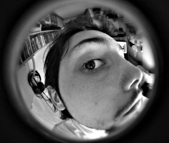 Door security system - Man looking through peephole