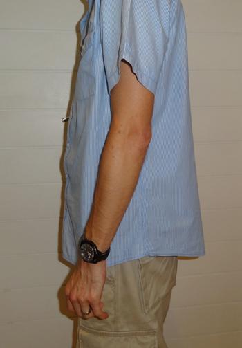 Pepper Spray can on belt - concealed under shirt