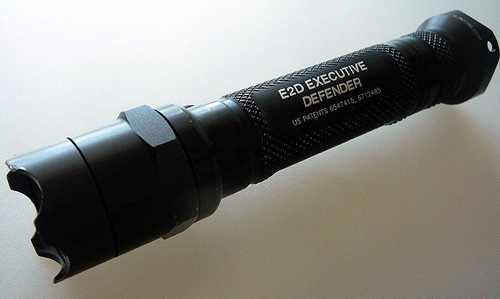 A Surefire E2D tactical flashlight