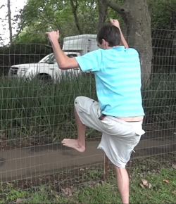 Fence test 3 - Evan climbing over a wire fence barefoot