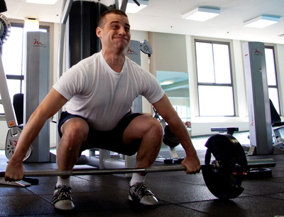 Muscular strength training - Man lifting barbell