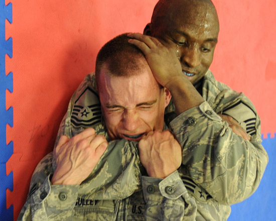Unarmed combat training - Two soldiers showing a strangle hold