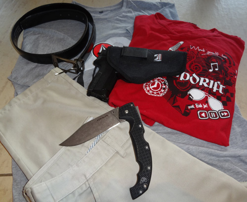 Clothing choices for self defense - Some clothes and weapons displayed on floor