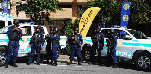 South African police standing near their cars