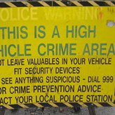 Crime safety tips - A yellow sign saying high vehicle crime area
