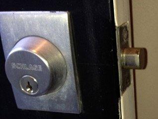 Deadbolt style lock on a door - Close up