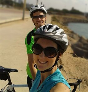 Evan and his wife cycling on a sunny day in South Africa