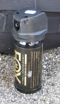 A can of Fox Labs brand of pepper spray on the ground
