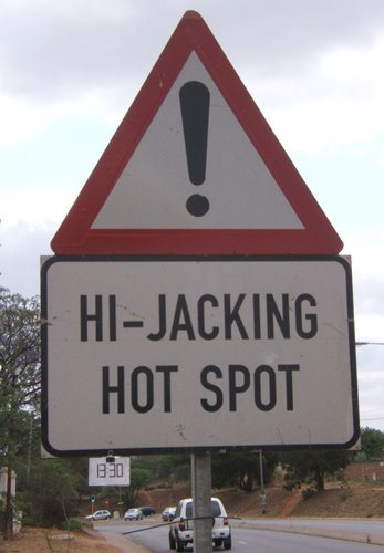 Hijacking - sign indicating a high risk of hijacking on this road