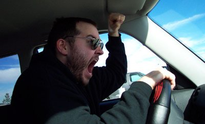 Road rage - A man is shouting at someone while driving