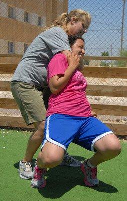Two women practicing a choke hold