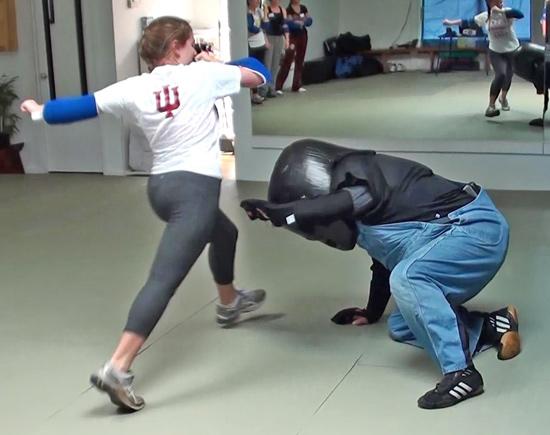 Model Mugging student kicks padded attacker in head
